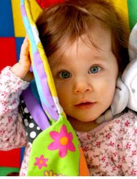 Help children 1 year old  learn how to play  with a toy